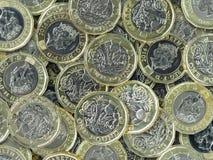 新的1英镑硬币-深堆 免版税库存照片