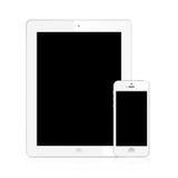 新的Ipad (Ipad 3)和查出的iPhone 5白色 库存图片