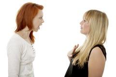 新红色和金发女孩生气 库存图片