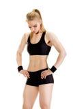 新肌肉妇女摆在 免版税库存照片