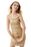 新背景美好的礼服金黄隔离的白人妇女 在丝毫的隔离 库存图片