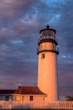 新英格兰灯塔在金黄光沐浴了在日落 免版税库存图片