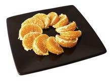 新蜜桔切片板材在白色背景的 图库摄影