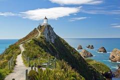 新西兰,在矿块点的灯塔 库存照片
