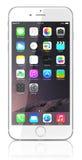 新银色iPhone 6正陈列有iOS的8家庭屏幕 免版税库存照片