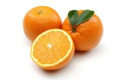 新鲜桔子和半橙色 库存照片