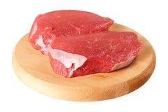 新鲜牛肉的董事会 免版税图库摄影