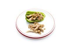 新鲜的切的鸡肉用辣椒的果实 免版税库存图片