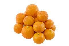 新鲜的堆成熟蜜桔 库存图片