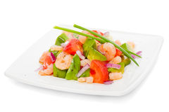 新鲜的大虾沙拉用鲕梨和蕃茄 免版税库存照片