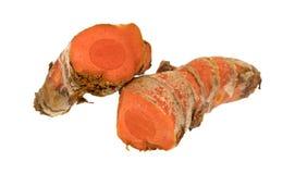 新鲜的姜黄根茎切成了两半 库存图片