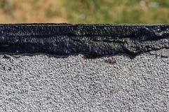 新鲜的屋顶湿补丁 库存照片