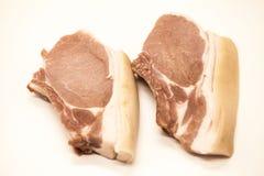 新鲜的未加工的在白色背景的猪肉开胃特写镜头片断  免版税库存图片