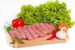 新鲜的未加工的牛肉在船上 免版税库存照片