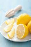 新鲜的柠檬切在蓝色 免版税图库摄影