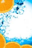 新鲜的桔子水 免版税图库摄影