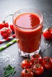 新鲜的汁液蕃茄 免版税图库摄影
