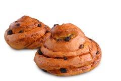 新鲜的甜漩涡小圆面包用葡萄干 免版税库存照片