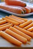 新鲜的红萝卜摆正画象旁边低模糊 图库摄影