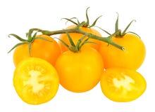 新鲜的藤成熟的琥珀色的蕃茄 免版税库存照片
