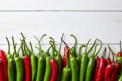 新鲜的辣椒的混合在白色木背景的 免版税库存图片
