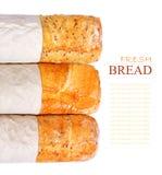 新鲜的麦子三个大面包在白色背景的 免版税库存照片