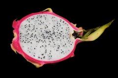 新鲜的龙果子在一个黑背景特写镜头切成了两半 库存照片