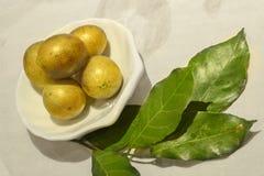 新鲜的wampee果子 免版税图库摄影