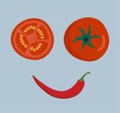 新鲜蔬菜在背景的微笑面孔 库存图片