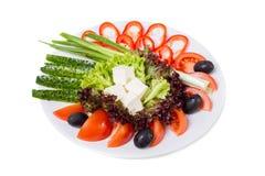 新鲜蔬菜开胃菜和希腊白软干酪 免版税库存图片