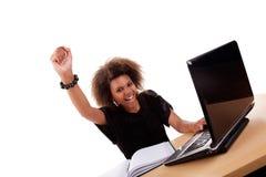 新黑人计算机前面的妇女 库存照片