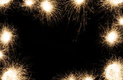 新年党在黑背景的闪烁发光物框架 库存照片