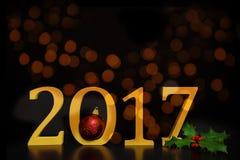 2017新年在金黄数字的` s前夕与圣诞节装饰 免版税图库摄影