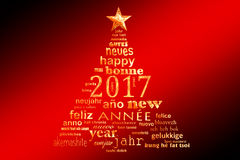 2017新年多语种文本词云彩贺卡,圣诞树的形状 库存图片