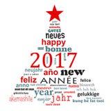 2017新年多语种文本词云彩贺卡,圣诞树的形状 免版税库存照片