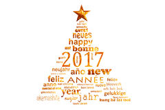 2017新年多语种文本词云彩贺卡,圣诞树的形状 免版税库存图片