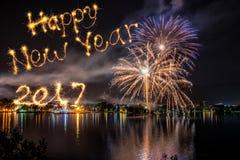 新年好写与烟花在烟花背景 免版税库存图片