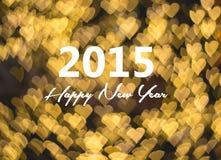 新年好卡片,金黄心脏背景 库存照片