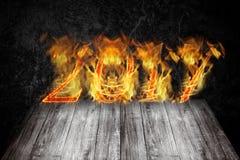 新年好2017年-在火焰的图 拼贴画 库存图片