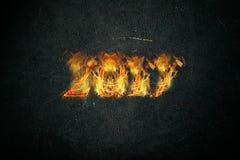 新年好2017年-在火焰的图 拼贴画 免版税库存图片