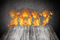 新年好2017年-在火焰的图 拼贴画 图库摄影