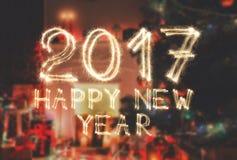 新年字体闪烁发光物在室背景编号 库存照片