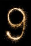 新年字体闪烁发光物在黑背景的第九 图库摄影