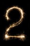 新年字体闪烁发光物在黑背景的第二 免版税库存照片