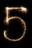 新年字体闪烁发光物在黑背景的第五 免版税库存图片