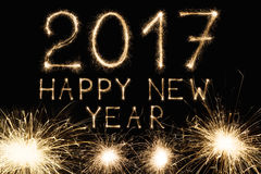 新年字体闪烁发光物在黑背景编号 免版税库存图片