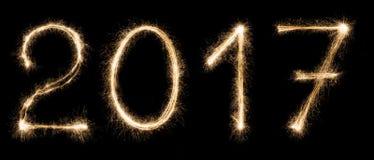 新年字体闪烁发光物在黑背景编号 免版税库存照片
