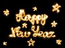 新年快乐做了闪闪发光在黑色 库存图片