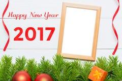 新年快乐2017年 圣诞节装饰和照片框架 库存图片