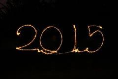 新年快乐- 2015年闪烁发光物 库存照片
